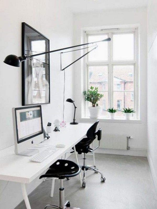 Quite simple white home office for two
