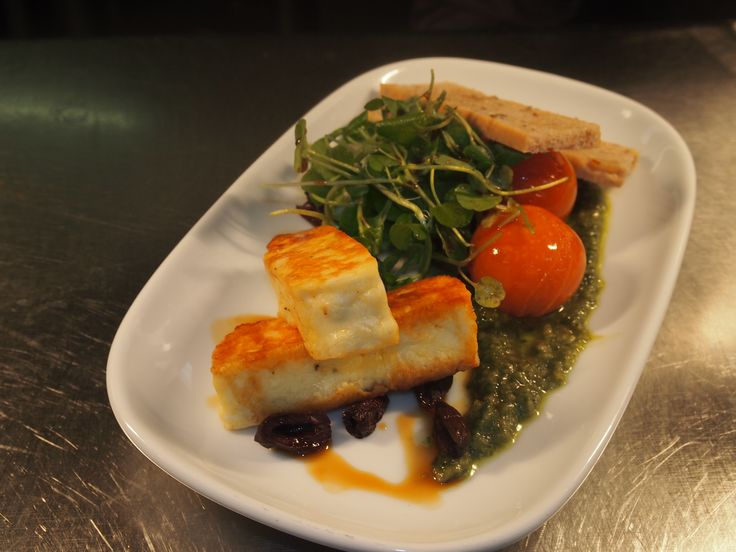 Grilled Haloumi Salad, confit cherry tomatoes, homemade walnut foccacia, oven dried olives, watercress.