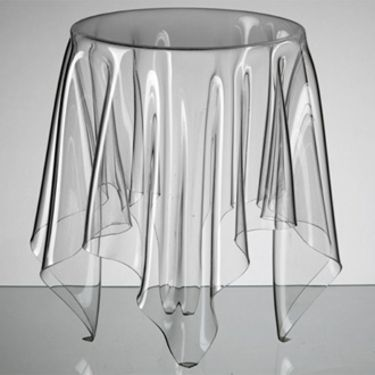 Illusion Table: Designed in 2005 by Danish designer John Brauer, the Illusion table is made out of 3mm-thick acrylic. It gives the impression that there is a tablecloth over a desk.