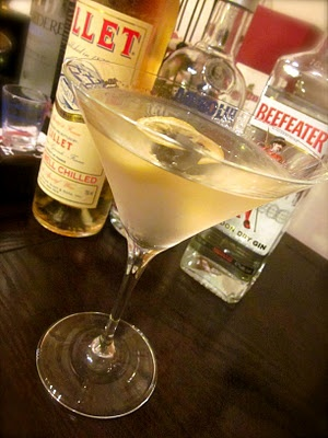 Vesper martini. Invented by James Bond in Casino Royale. Three measures of Gordon's gin, one of vodka (preferably grain), half a measure of Lillet. Shaken (not stirred) with ice, then served with a large, thin slice of lemon peel. Since I love 007, Casino Royale, *and* the name Vesper, I'm pretty well required to try this (right?)!