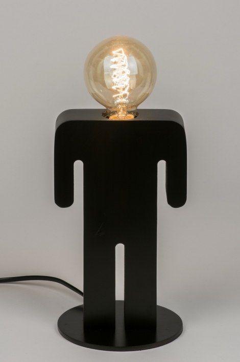 Klik voor webwinkel op deze link : https://www.rietveldlicht.nl/artikel/tafellamp-72252-modern-landelijk-rustiek-design-zwart-mat-hout  Deze tafellamp heeft de vorm van een mannenfiguur en is gesneden uit één stuk hout. Het hout is fraai van afwerking en uitgevoerd in een mat zwarte kleur. Het mannetje krijgt zijn karakter door toevoeging van de lichtbron. De lichtbron vormt het hoofd. Geadviseerd wordt het gebruik van een led sierlamp (kooldraadlamp).