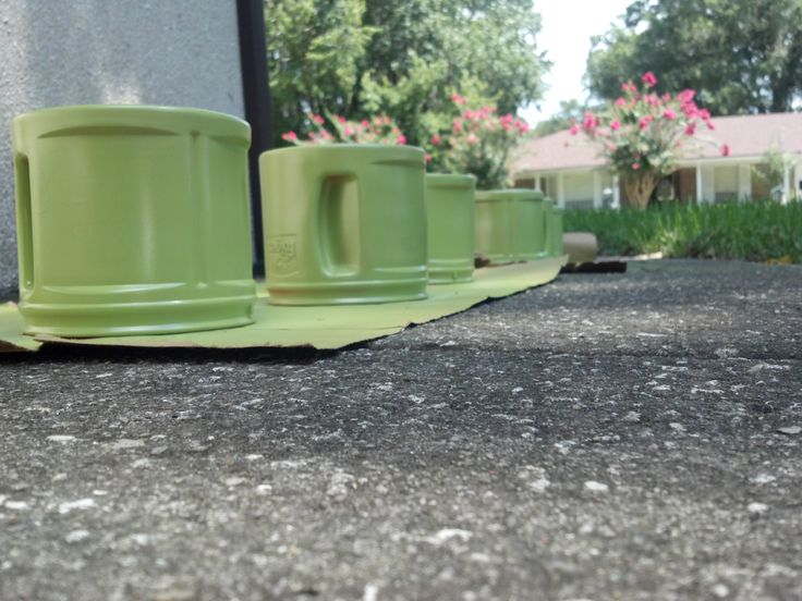 Folgers plastic coffee containers. Spray painted with Valspar plastic paint. (7 containers, 1 can of spray paint)