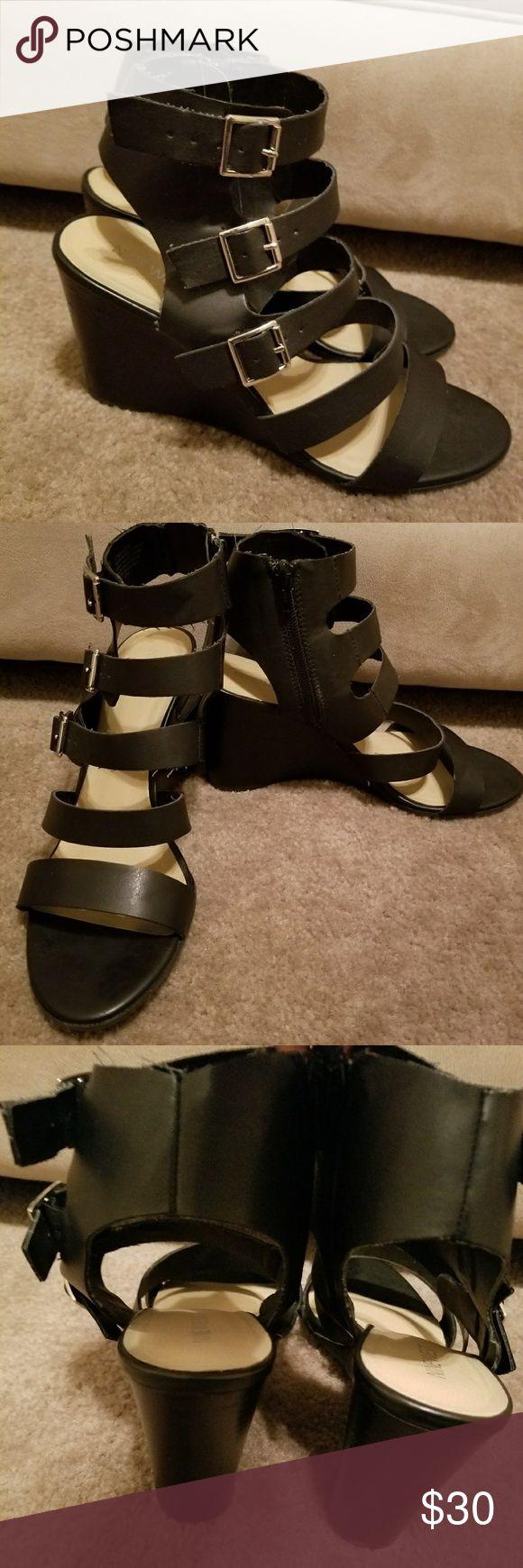 Black wedges Black wedges with buckles,zipper on the inside Nine West Shoes Wedges