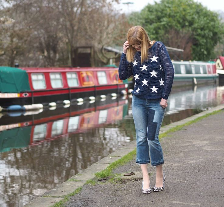 Patch cropped frayed edge jeans with a star jumper and zebra print shoes