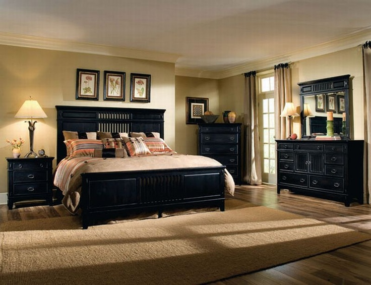 Bedroom with sand y tan walls with black furniture for Paint colors for bedroom with dark furniture