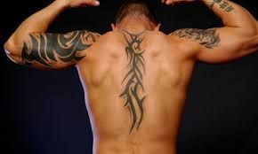 Image result for tribal back tattoos for guys