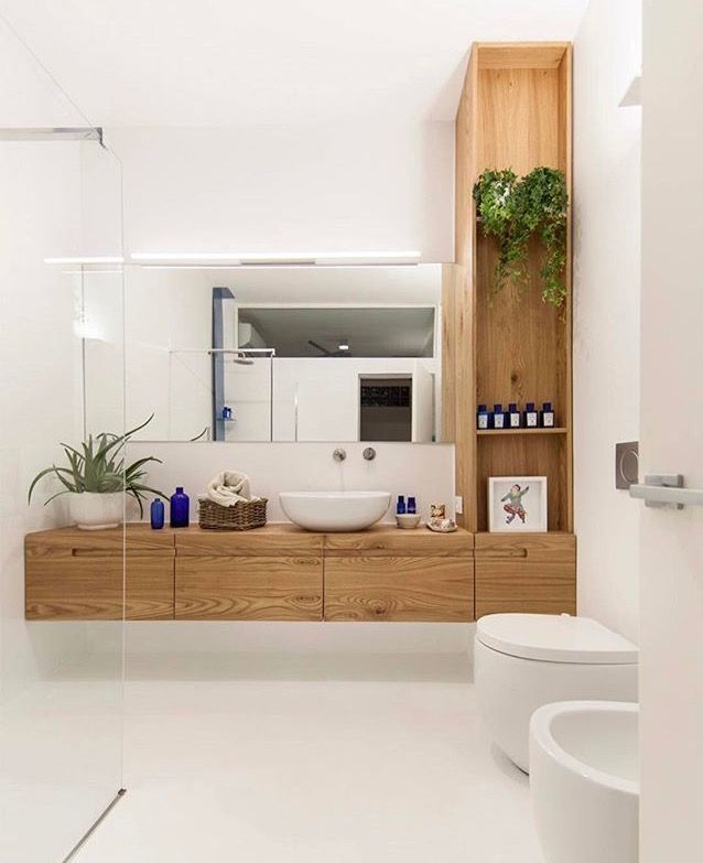 Pure White Bathroom With Wood Furniture