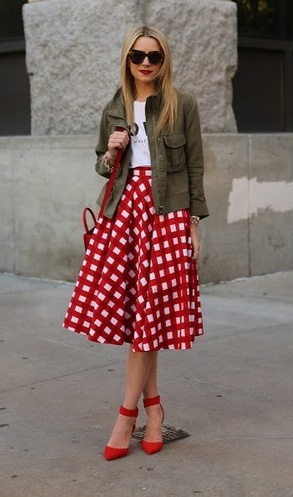 white tee + khaki jacket + gingham style full skirt + red pointy strap courts + sunglasses = chic with an edge