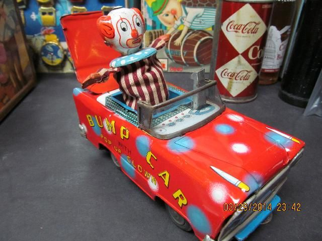 icollect247.com Online Vintage Antiques and Collectables - BUMP CAR WITH POP OUT CLOWN FRICTION TIN LITHO CAR 1950S