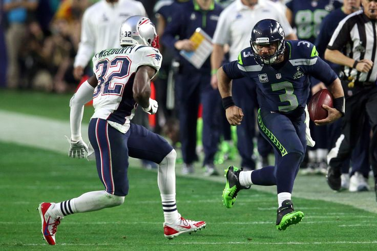 Russell Wilson #3 of the Seattle Seahawks runs with the ball against Devin McCourty #32 of the New England Patriots during Super Bowl XLIX at University of Phoenix Stadium on February 1, 2015 in Glendale, Arizona.
