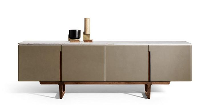 A low cabinet for the living room. Deliberately lean design, precious materials. Functional details become highly characteristic aesthetic elements, such as the recessed handles that provide interesting graphics on the surfaces. Intense contrast also between the dark, warm hues of Cuoio Saddle Extra leather and the wood covering the outside and the bight explosion of the very pale natural maple used inside the compartments. Formal minimalism and sophisticated finishes for an…