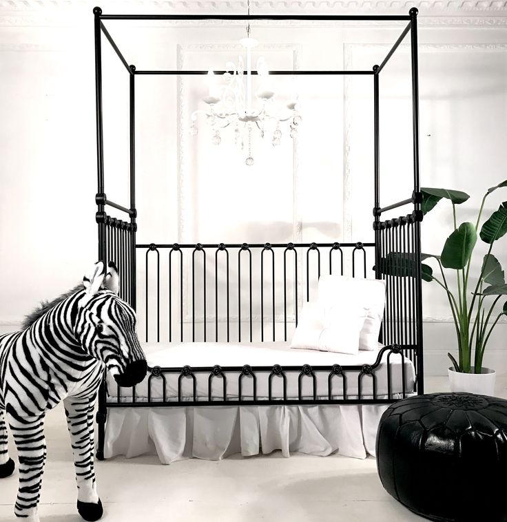 The joy canopy crib slays as a toddler bed.  Love the black and white nursery.