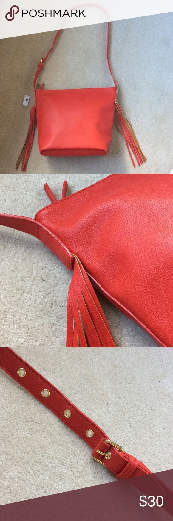 GAP Purse GAP large red purse with zipper and fringe detail. Gold hardware. One interior zippered pocket. Fake leather. GAP Bags