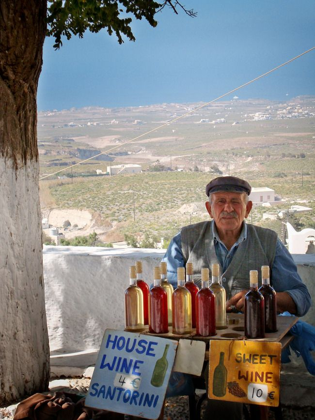 Wine for sale on the side of the road outside of the village of Pyrgos, Greece this is beautiful.