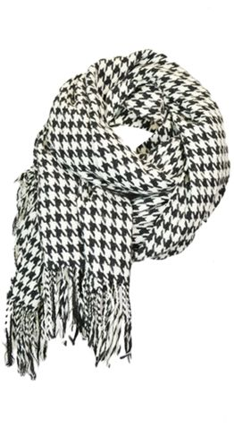 """Kallie Shawl $39.95 CAD An oversized shawl that can be worn as a scarf. Houndstooth is a pattern needed in every womens closet this season. Can be worn as a scarf Oversized shawl with tassels One size 34"""" wide 76"""" long 100% Acrylic"""