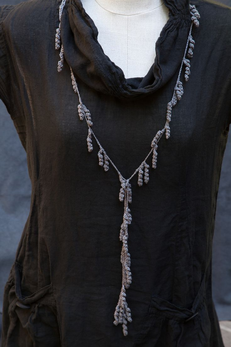 crochet lariat necklace...inspiration only...looks like a crochet chain and crocheted spirals..