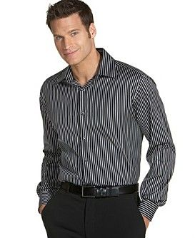 Attractive shirt, tailored belt, simple pants = perfect biz casual look for men.