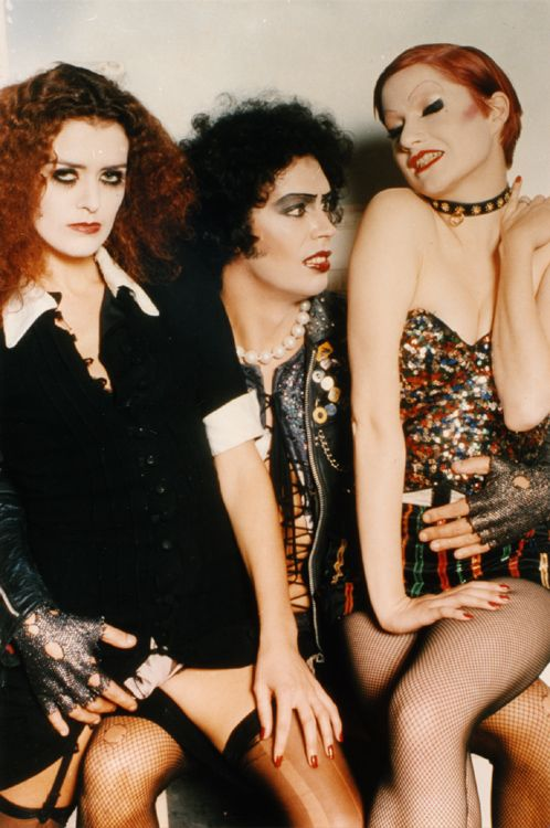 Little Nell and Patricia Quinn sitting on Tim Curry's lap