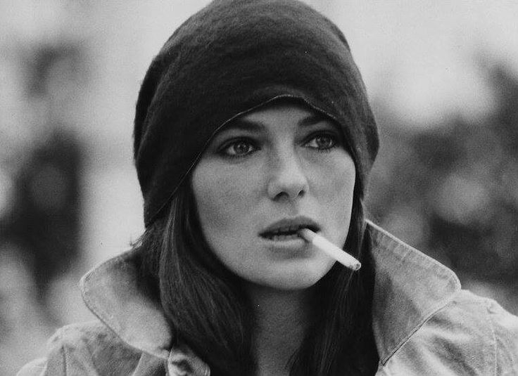 Jacqueline Bisset smoking a cigarette (or weed)