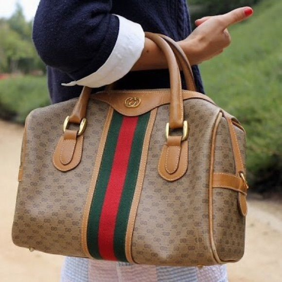 {Gucci} Vintage Boston Bag 100% authentic vintage Gucci Classi Boston bag in monogram canvas.  Suede interior with gold hardware and sporty stripe accent.  Amazing condition for its age!  From the 1960's.  More pictures in my closet, ask me any questions. Gucci Bags Satchels
