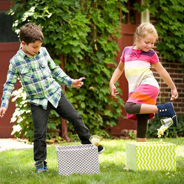Popcorn Drop: Attach cups of popcorn to your shoes and hustle across the lawn trying not to spill! The team with the most popcorn at the end of the relay race wins! (via BHG)