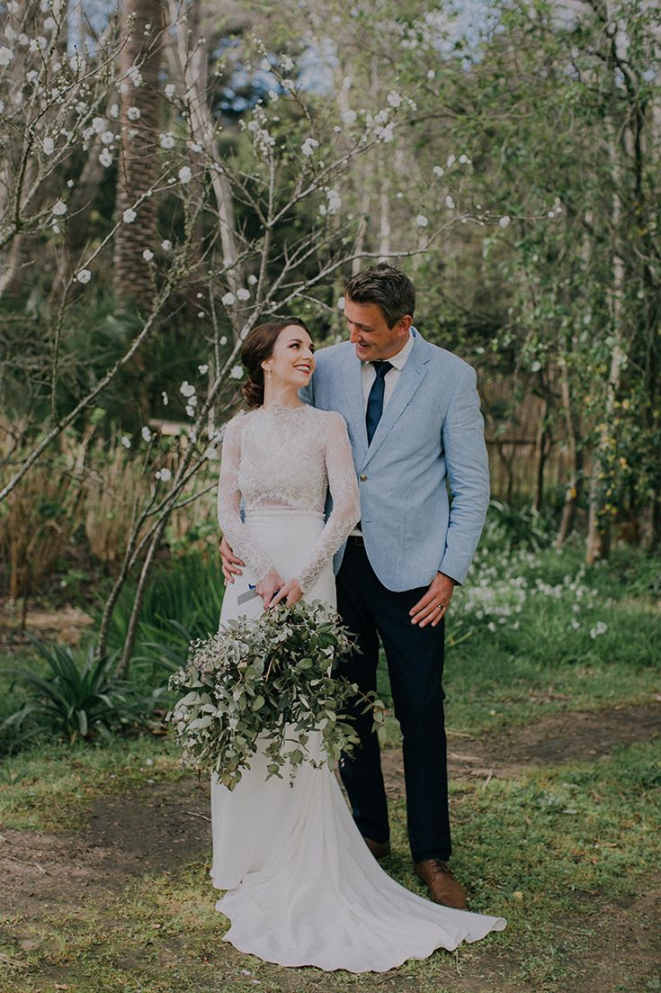 Dreamy Spring wedding inspiration with a touch of white blossoms in the background. Looks so pretty paired with the groom's powder blue suit.