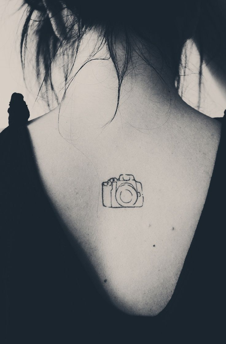 camera tattoo... Show your love for photography with an unembellished camera tattoo. The simplicity of the design is aesthetically pleasing and artsy.