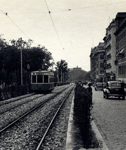 Paseo del Prado in the 40s. In the background can be distinguished the silhouette front of Atocha Station, Madrid, Spain