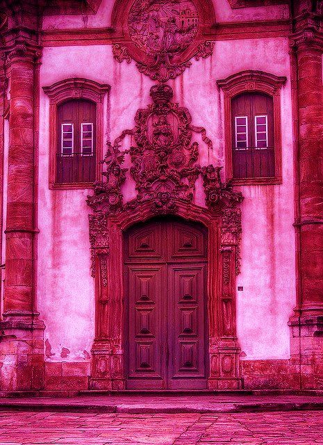 A pink filter has obviously been used as even the street is pink. Still a lovely door though.