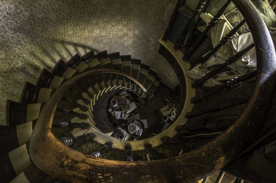 Spiral staircase in abandoned house, Hamilton, Ontario