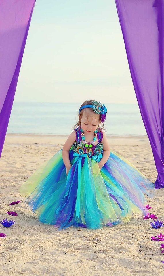 Peacock Flower girl dress #Peacock #Wedding … Wedding #ideas for brides, grooms, parents & planners https://itunes.apple.com/us/app/the-gold-wedding-planner/id498112599?ls=1=8 … plus how to organise an entire wedding, within ANY budget ♥ The Gold Wedding Planner iPhone #App ♥ For more inspiration http://pinterest.com/groomsandbrides/boards/ #green #purple #turquoise #peacock #feathers #ceremony #reception