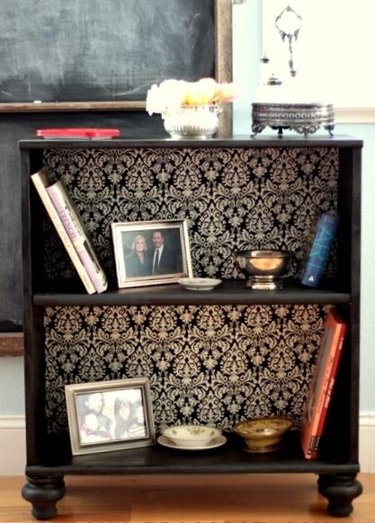 Add wallpaper and feet to old bookcase- cute and cheap!