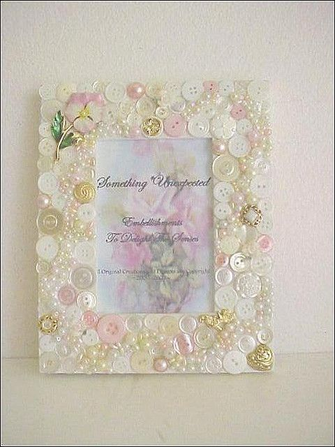 button frame. Not a big fan of button crafts but I thought this was so pretty. Love the pearl with the pink