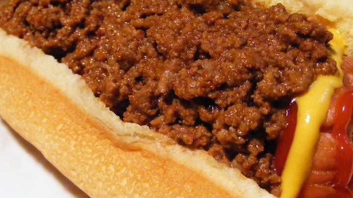 This savory beef topping takes hotdogs to a whole new level. Ground beef simmers with tomato sauce, ketchup, chili powder, crushed red peppers, and a touch of sugar.