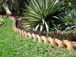 Recycling the roof | La Gringa's Blogicito using clay roof tiles as garden edgers! Love it!