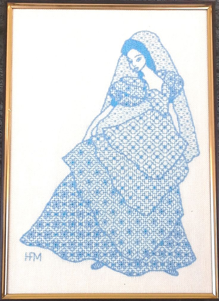 A Spanish lady in Queens stitchery. Each layer of the skirt is the same pattern with an added element.
