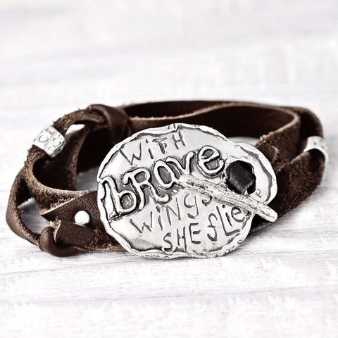 "A unique adjustable leather wrap bracelet with ""with brave wings she flies"" carved into the toggle. Shop more of our inspirational handmade jewelry>>www.islandcowgirl.com"