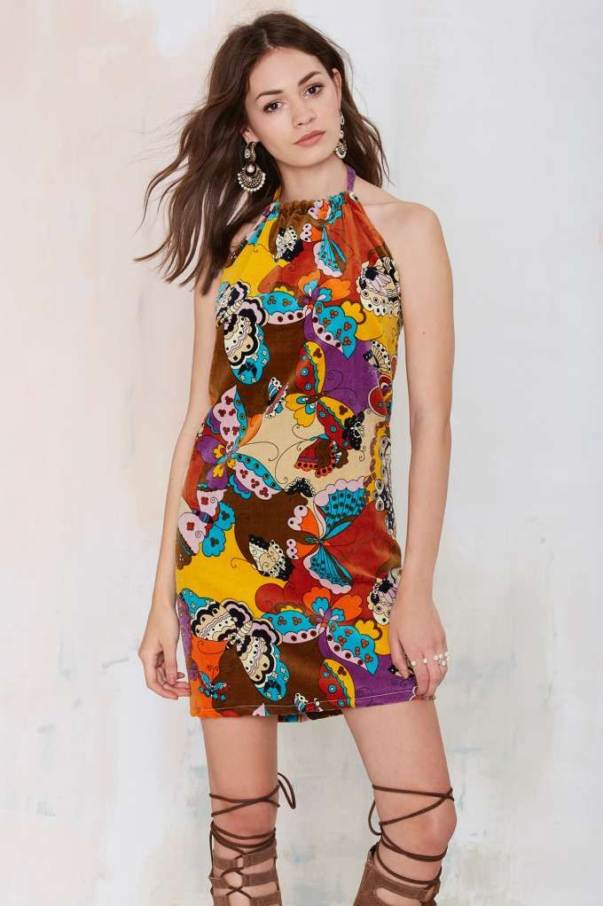 This vintage '60s dress is made in a soft felt material and features psychedelic butterfly print in brown, beige, orange, lilac, yellow, black, purple, rust, and blue.