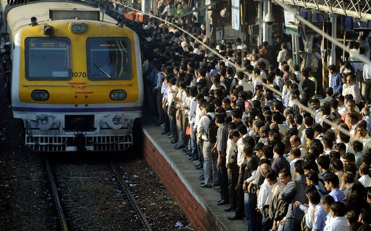 #Commuters prepare to catch a #train during rush hour at a suburban railway station in #Mumbai