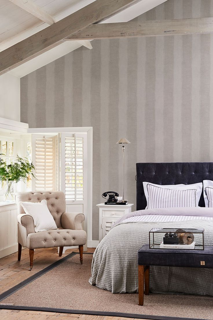 This linen stripe wallpaper creates a comforting backdrop in this bedroom space perfect for relaxing after a busy day! Pattern 18360.