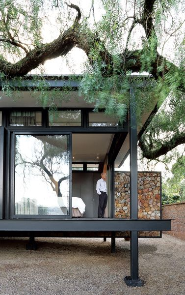 With a steel frame, a private aerie in Johannesburg is elevated in more ways than one. In the bedroom, floor-to-ceiling glass doors slide...