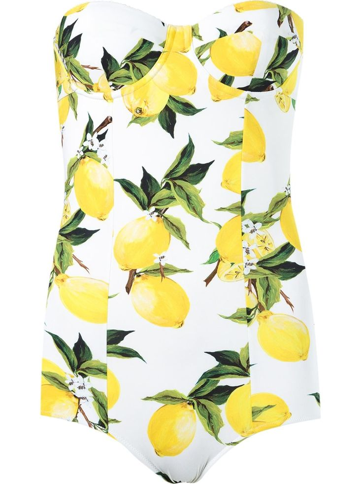 DOLCE & GABBANA Taking inspiration from their native Sicily, Dolce & Gabbana gives a tropical twist to this bright white and yellow lemon print swimsuit. Featuring a detachable and adjustable shoulder strap, a sweetheart neckline, a rear hook and eye fastening and a cut-out back, this Dolce & Gabbana one piece is a great choice for lounging around the pool on sun-soaked days.