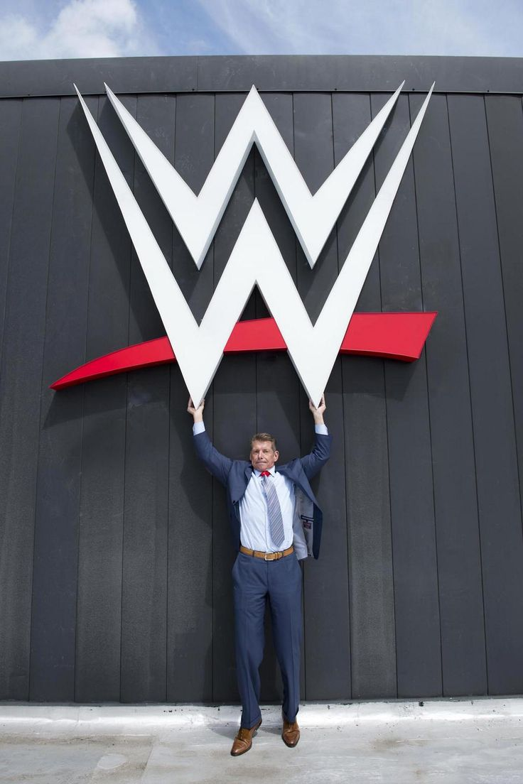 Vince McMahon carrying the WWE logo.