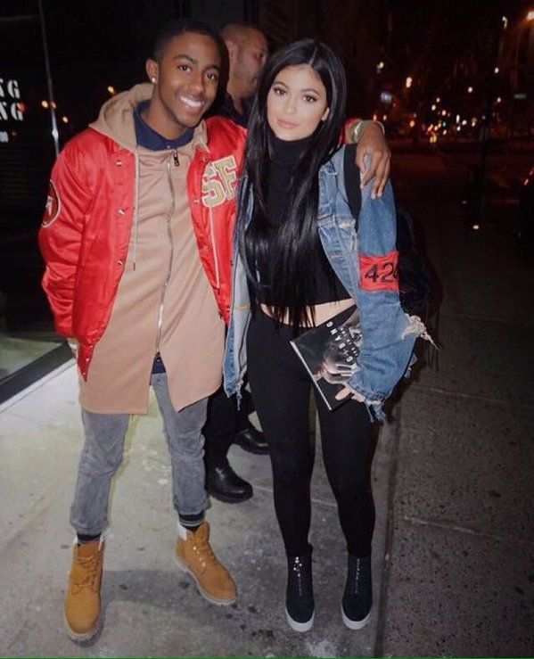 kylie jenner with fan jeans jacket black long hair
