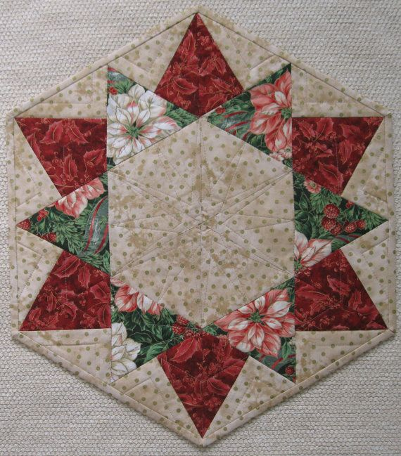 I have the pattern for this!  But it is neat to see it in different color combinations! Christmas table topper