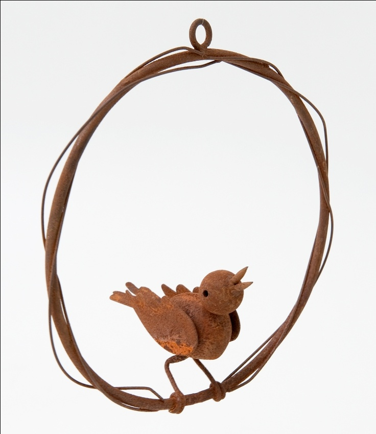 Hanging metal bird sculpture