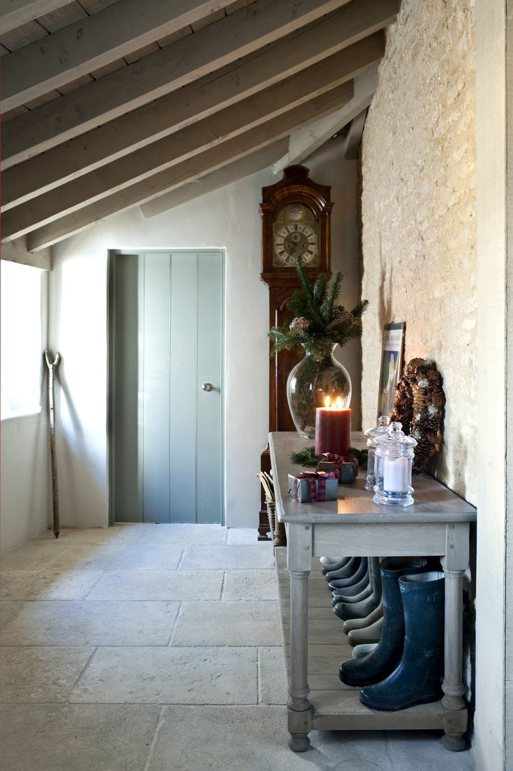 Love the combination of wooden doors and console table with the natural stone wa…