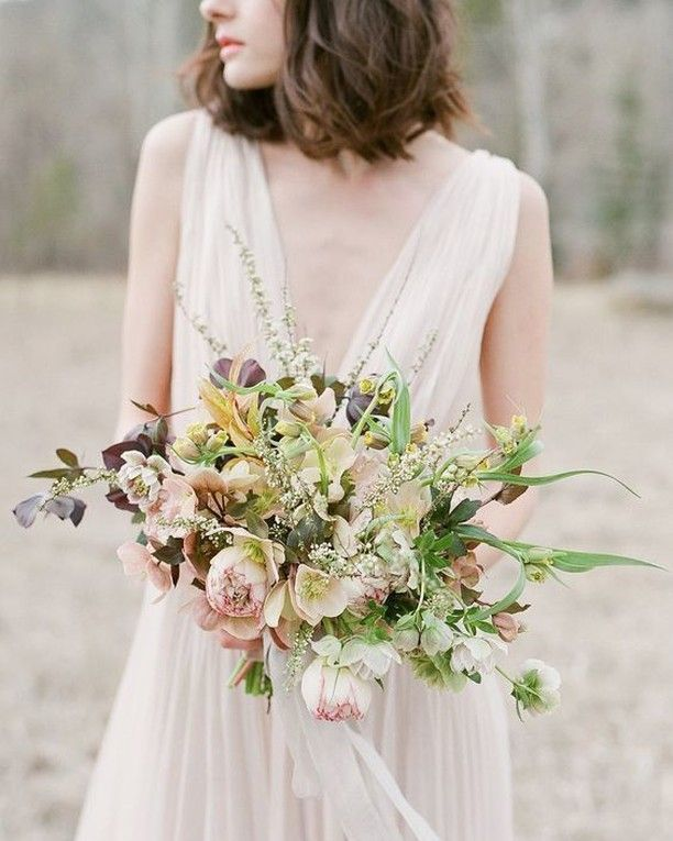 An incredible amount of texture keeps this bouquet from feeling too precious or overly bridal. Designed by @sarah_winward -- learn more from her about floral design through her online course at @ifimade_. Planning: @lauriearons | @mrdanieltran | Gown: @j_mendel via @lwdbridal | Hair and Makeup: @sherrielong | Photo: @josevilla.  #weddingflowers #bridalbouquet #weddingbouquet #ifimadeweddingflowers
