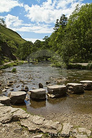 Landscapes Places Scenery:  The famous stepping stones across the River Dove at Dovedale, England.