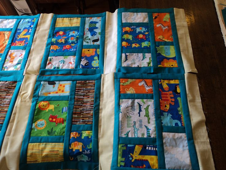 First quilt for my niece Nina to celebrate the birth of her first born.  This photo shows some of the blocks used before they were sewn together.